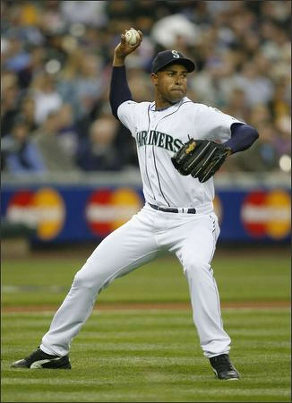 Seattle Mariners Miguel Batista throws out Oakland's Milton Bradley in the 1st inning against the Oakland Athletics at Safeco Field on Wednesday April 4, 2007.