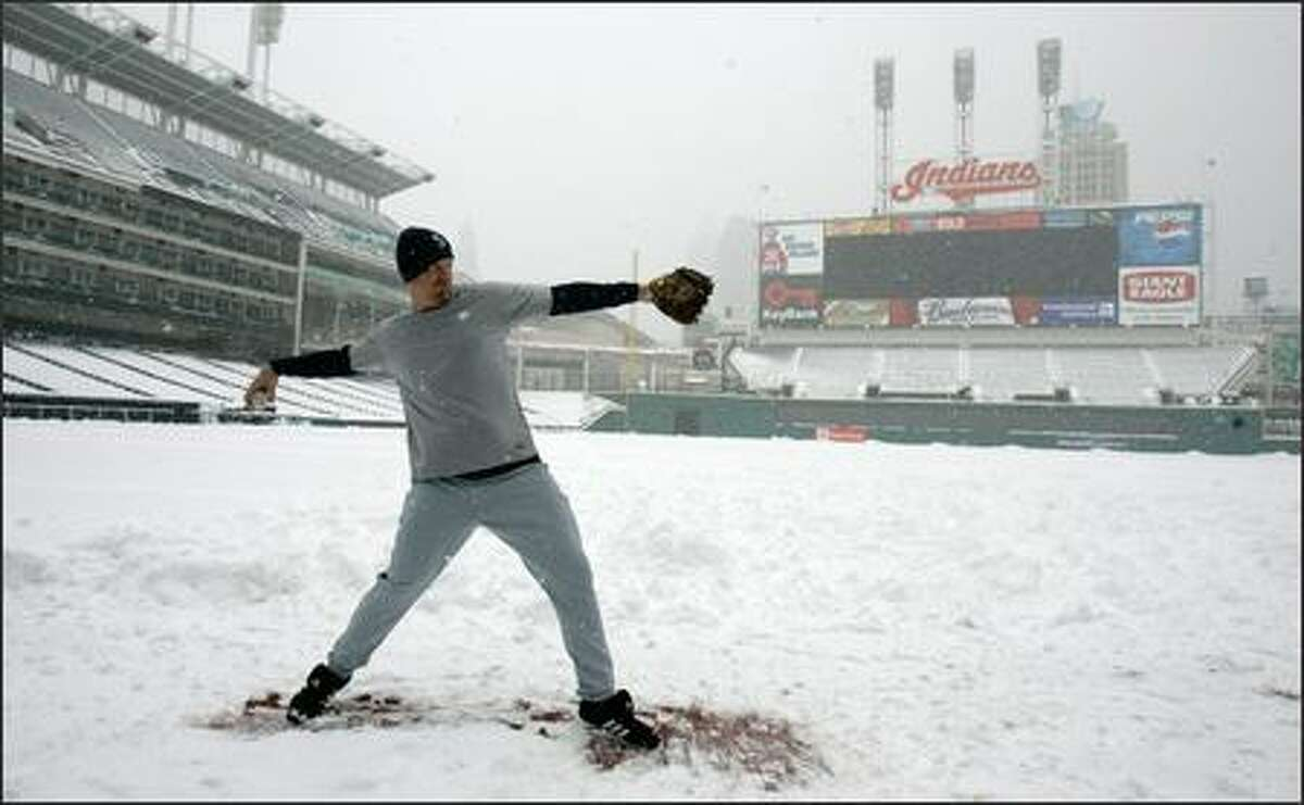 Mariners closer J.J. Putz gets some throwing in at snow-blanketed Jacobs Field.