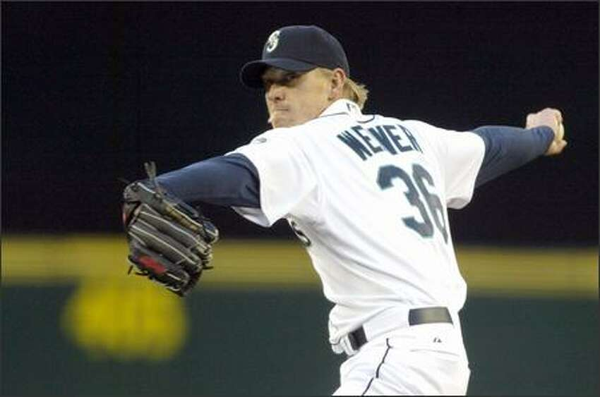 Seattle Mariners pitcher Jeff Weaver in his first start as a Mariner throws against the Minnesota Twins on Tuesday at Safeco Field during the first inning in Seattle.
