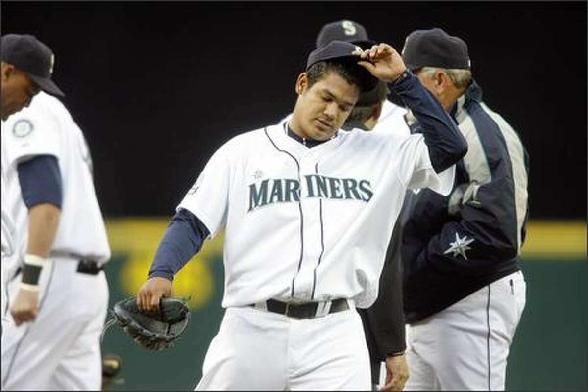 Felix Hernandez leaves the mound with a strained elbow.