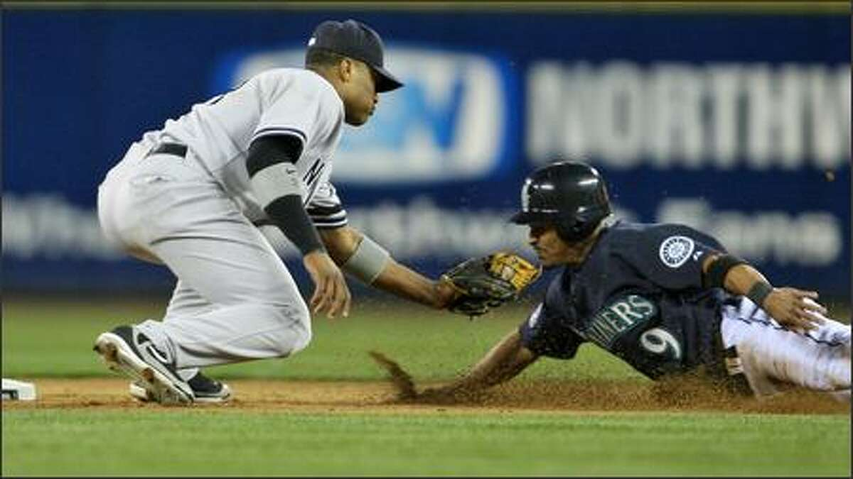 Jason Ellison is tagged out by Robinson Cano during the eighth inning.