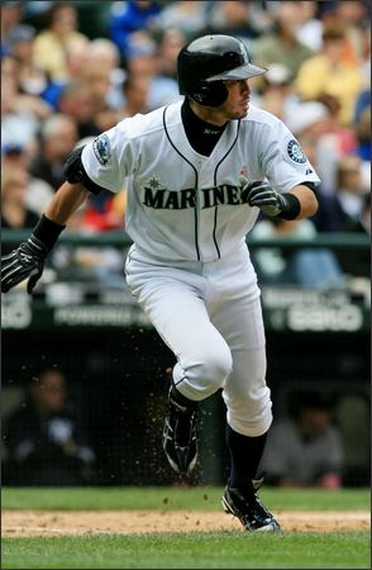 Seattle Mariners' Ichiro Suzuki hustles out a single, his first of two on the day, against New York Yankees' Andy Pettitte, during the 3rd inning. Ichiro later scored on a hit by Raul Ibanez.