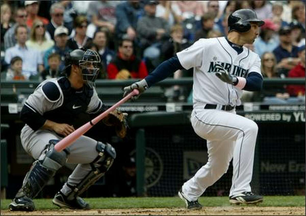 Seattle Mariners' Raul Ibanez connects for a RBI single to score Ichiro Suzuki against the New York Yankees' Andy Pettitte during the 3rd inning.