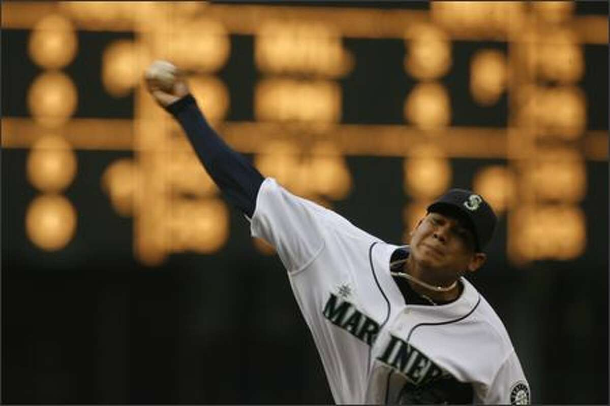 Felix Hernandez pitches against the Los Angeles Angels in the first inning at Safeco Field.