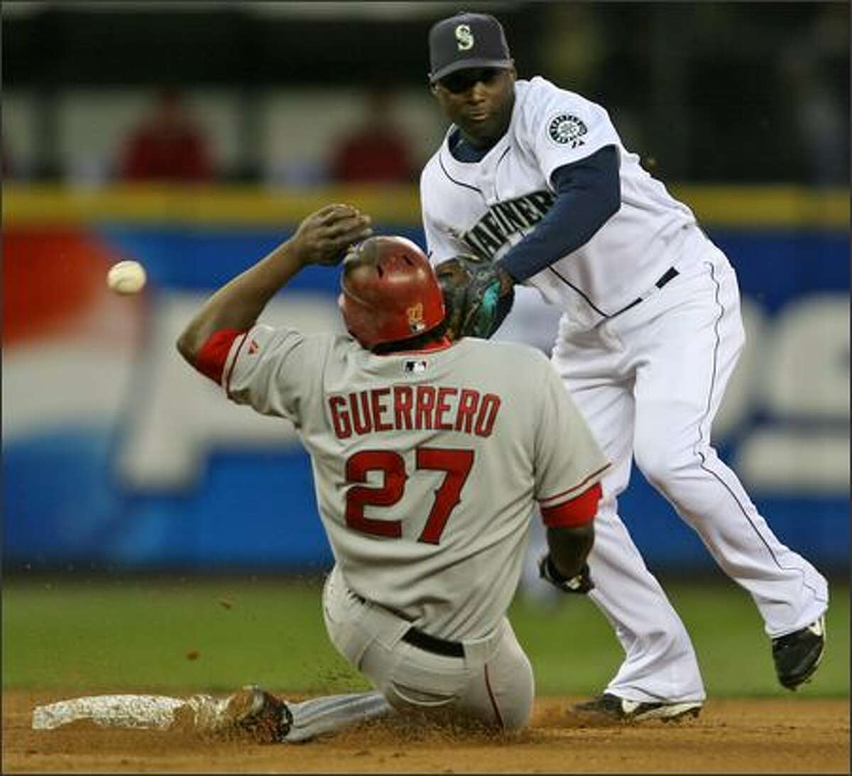 Yuniesky Betancourt bobbles a throw from Jose Lopez at second base, failing to force out Los Angeles' Vladimir Guerrero in the sixth inning.