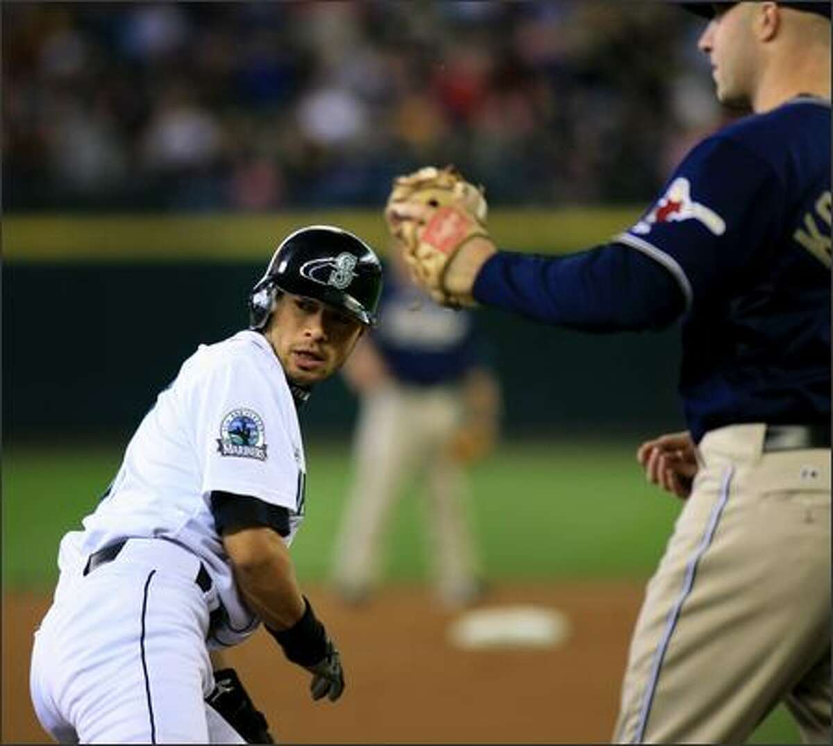 Seattle Mariners Ichiro Suzuki looks to the umpire after being tagged out by San Diego Padres third baseman Kevin Kouzmanoff on a throw from catcher Josh Bard during the 1st inning. Ichiro stole second earlier in the inning.