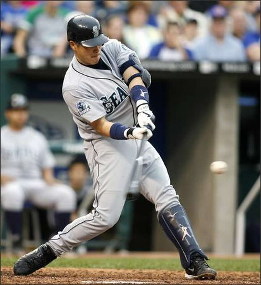 Kenji Johjima hits a grand slam in the fourth inning. (AP Photo/Ed Zurga) Photo: Associated Press / Associated Press
