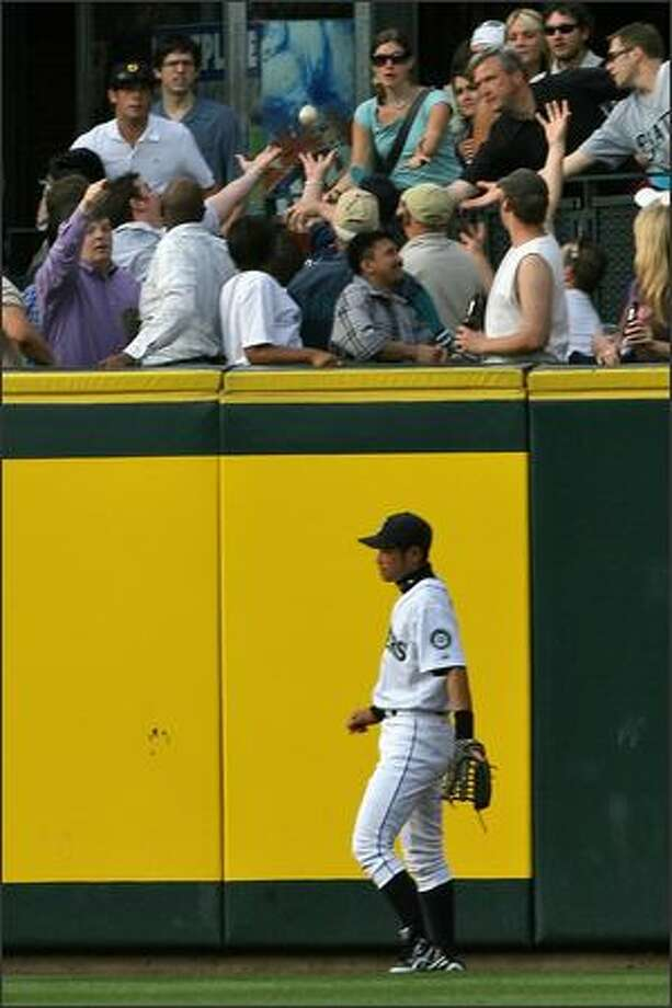 Seattle Mariners Ichiro Suzuki turns away as Texas Rangers Michael Young's ground-rule double bounces into the stands during first inning action at Safeco Field. Photo: Mike Urban, Seattle Post-Intelligencer / Seattle Post-Intelligencer