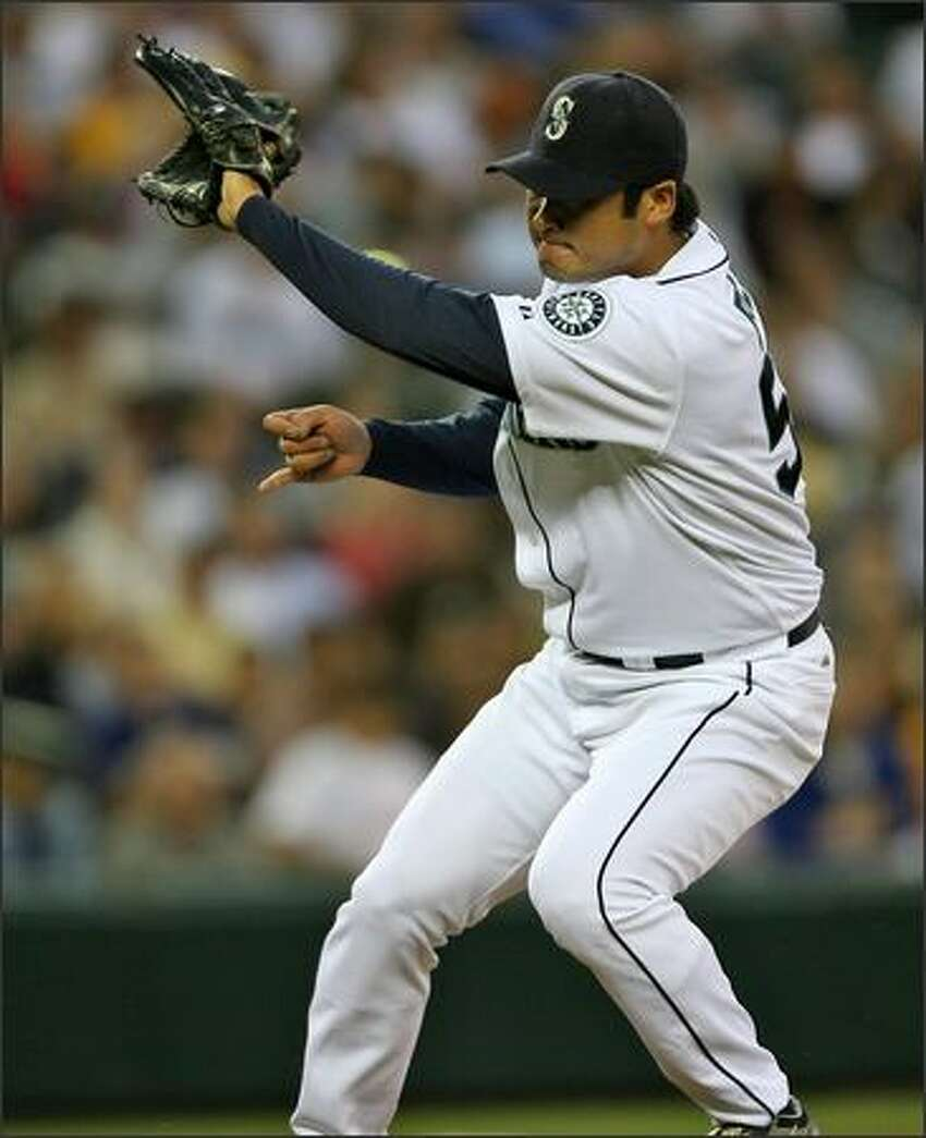 Seattle Mariners Cha Seung Baek stops a hard grounder from Texas Rangers' Marlon Byrd during the sixth inning at Safeco Field.
