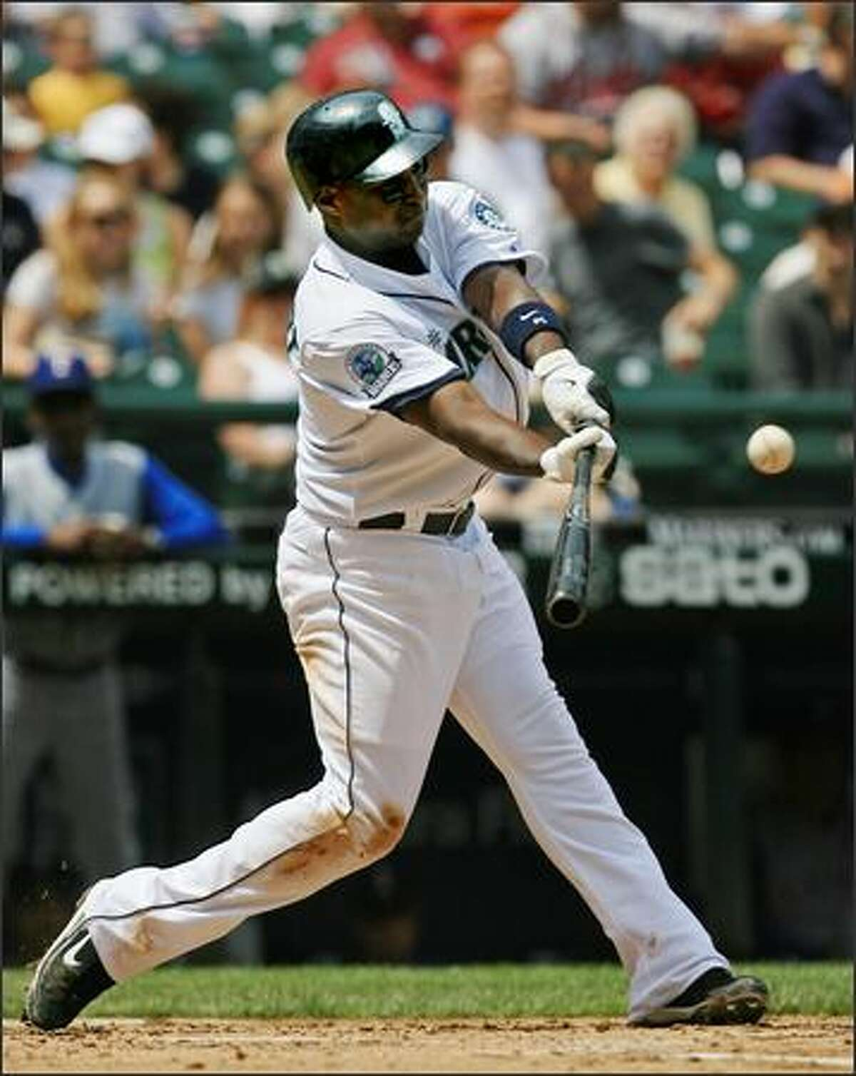 Seattle Mariners' Yuniesky Betancourt doubles off Texas Rangers starter Robinson Tejeda to extend his hitting streak to 15 games during the 2nd inning.
