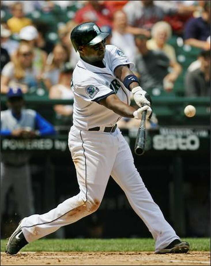 Seattle Mariners' Yuniesky Betancourt doubles off Texas Rangers starter Robinson Tejeda to extend his hitting streak to 15 games during the 2nd inning. Photo: Dan DeLong, Seattle Post-Intelligencer / Seattle Post-Intelligencer