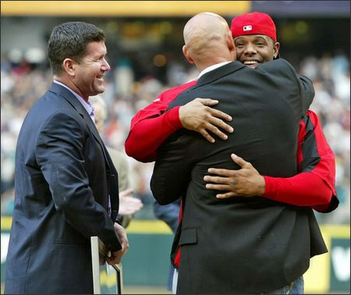 Ken Griffey Jr., right, embraces Jay Buhner as Edgar Martinez joins in the merriment during pregame ceremonies at Safeco Field.