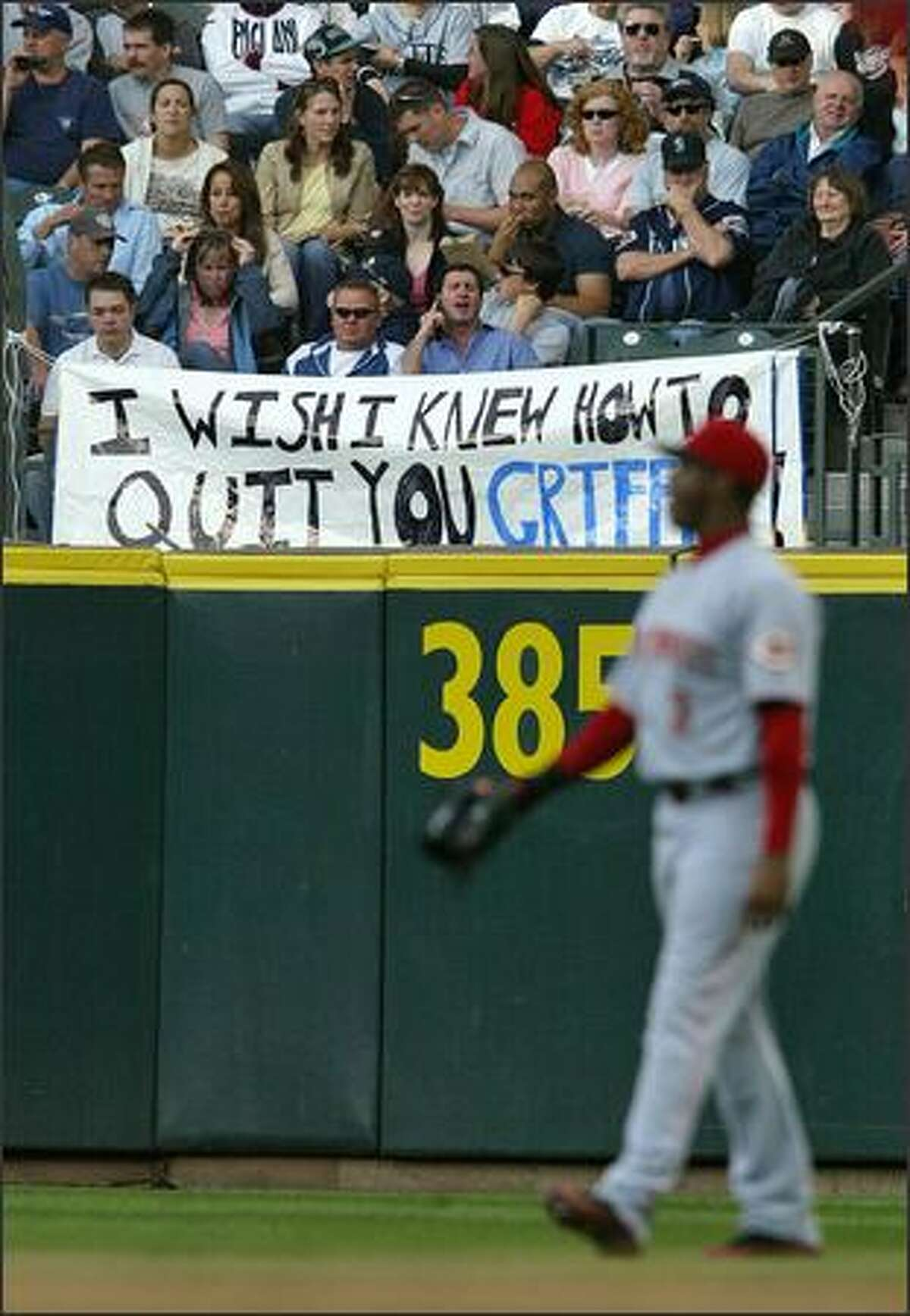 Fans in right field hold up a sign Ken Griffey Jr.
