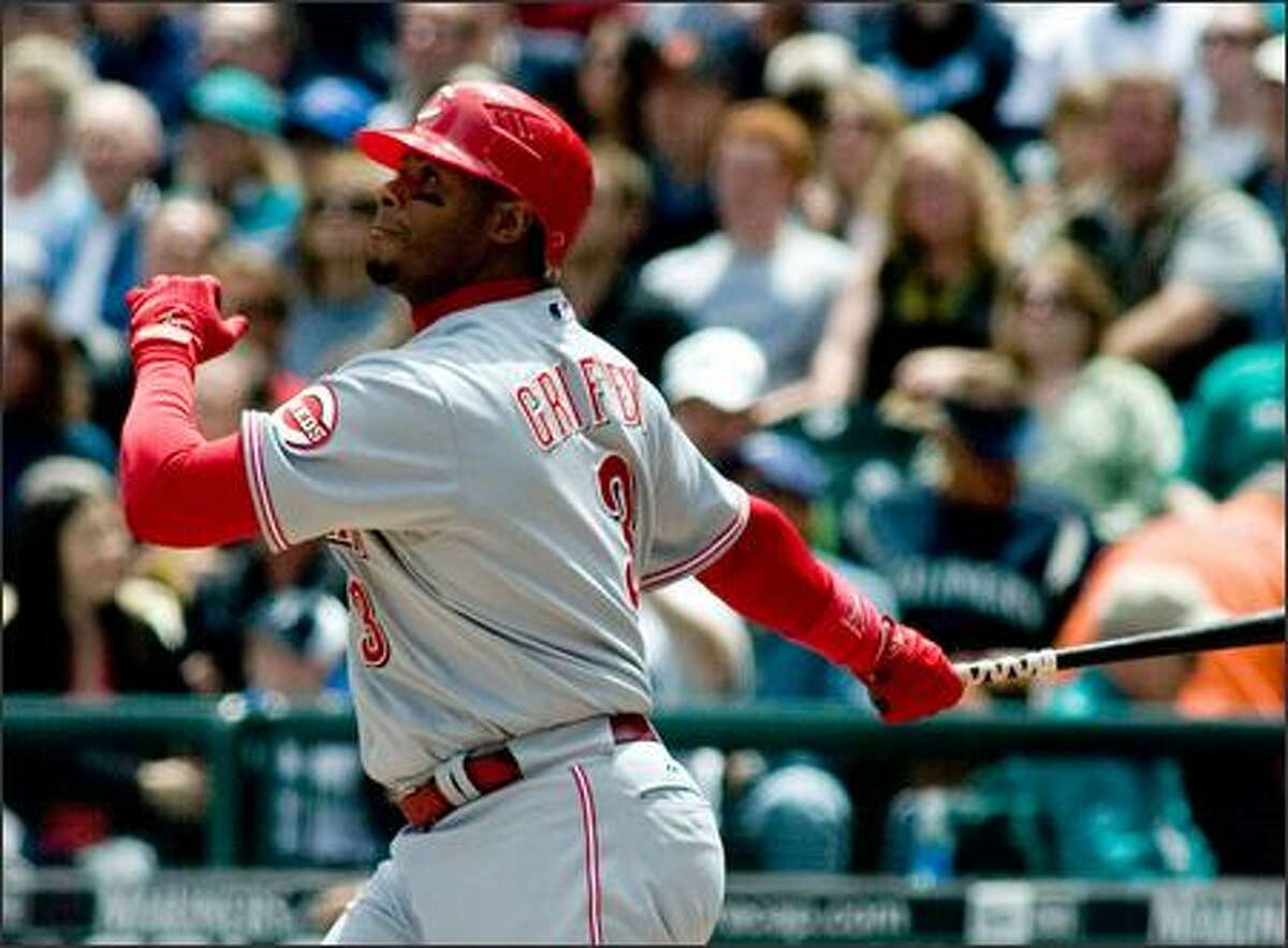 Ken Griffey Jr. watches the ball sail away into left field for his first of two home runs in Sunday's game.