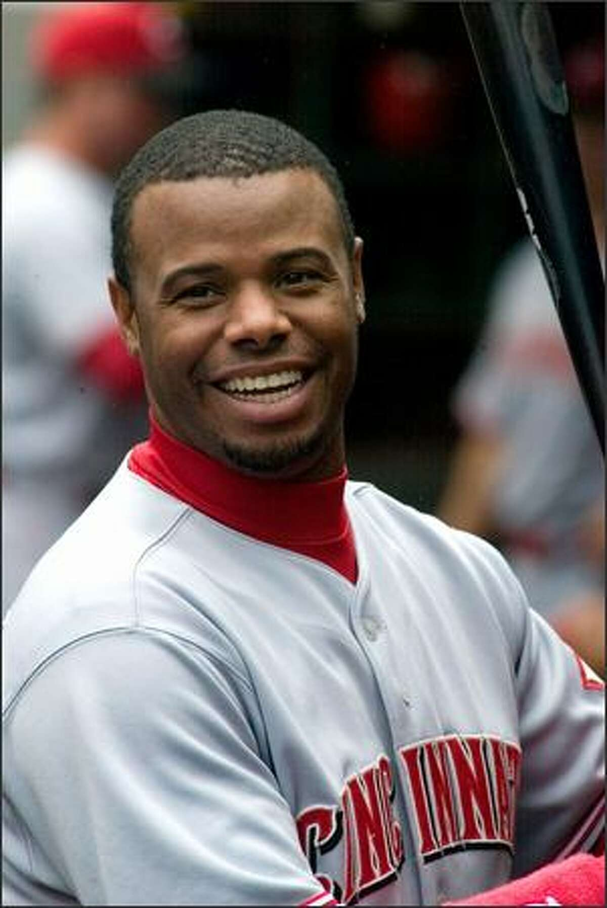 Ken Griffey Jr., smiles before his team, the Cincinnati Reds, take the field against the Mariners.