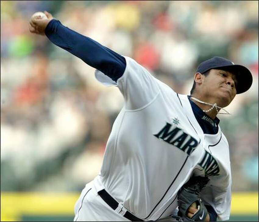 Seattle Mariners Felix Hernandez starts against the Boston Red Sox during first inning action at Safeco Field in Seattle on Tuesday.