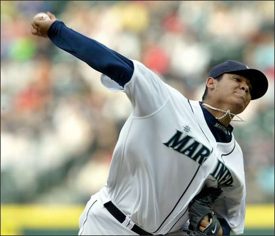 Seattle Mariners Felix Hernandez starts against the Boston Red Sox during first inning action at Safeco Field in Seattle on Tuesday. Photo: Mike Urban, Seattle Post-Intelligencer / Seattle Post-Intelligencer