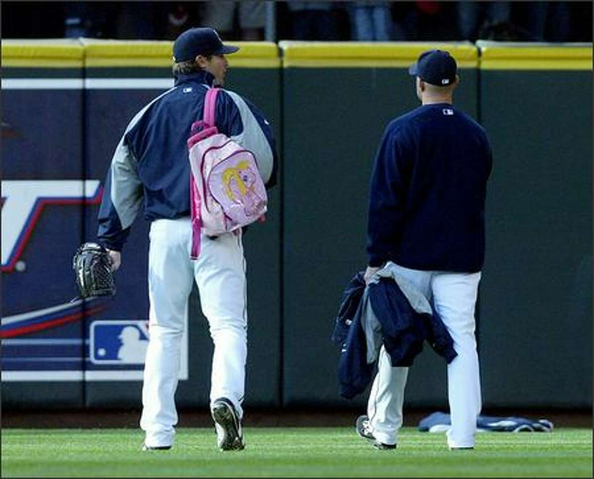 Mariners rookie pitcher Ryan Rowland-Smith walks out to the bullpen toting his