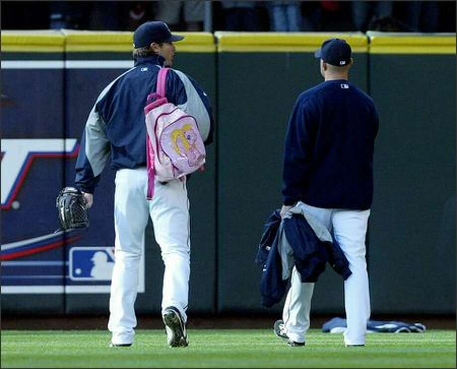 "Mariners rookie pitcher Ryan Rowland-Smith walks out to the bullpen toting his ""My Little Pony"" backpack, part of rookie hazing, prior to the Toronto-Seattle game. Photo: Mike Urban, Seattle Post-Intelligencer / Seattle Post-Intelligencer"