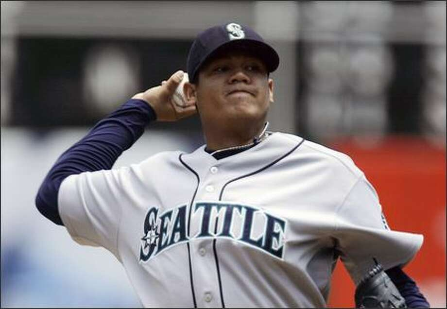 Seattle starter Felix Hernandez works in the first inning. Hernandez gave up just two hits over eight innings and didn't allow an Oakland baserunner past second. (AP Photo/Ben Margot) Photo: Associated Press / Associated Press