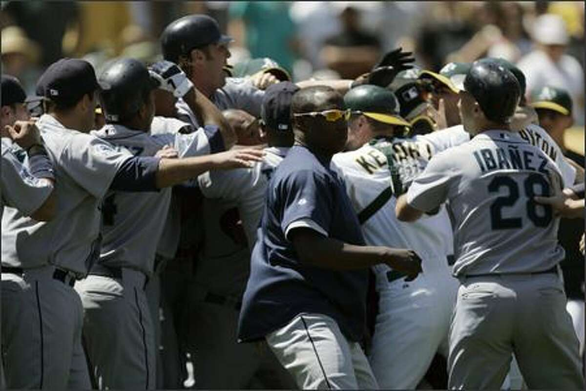 Seattle Mariners and Oakland Athletics clear the benches during a seventh-inning altercation. (AP Photo/Ben Margot)