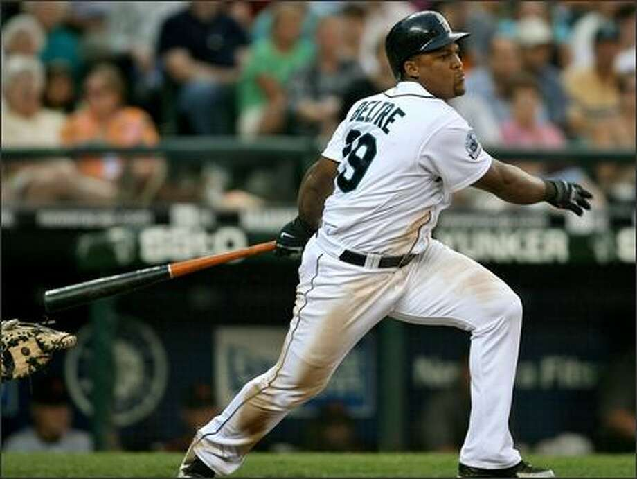 Adrian Beltre singles to right field with two outs in the fifth inning, scoring Jose Vidro, Jose Guillen and Richie Sexson for a 3-2 Seattle lead. Photo: Mike Urban, Seattle Post-Intelligencer / Seattle Post-Intelligencer