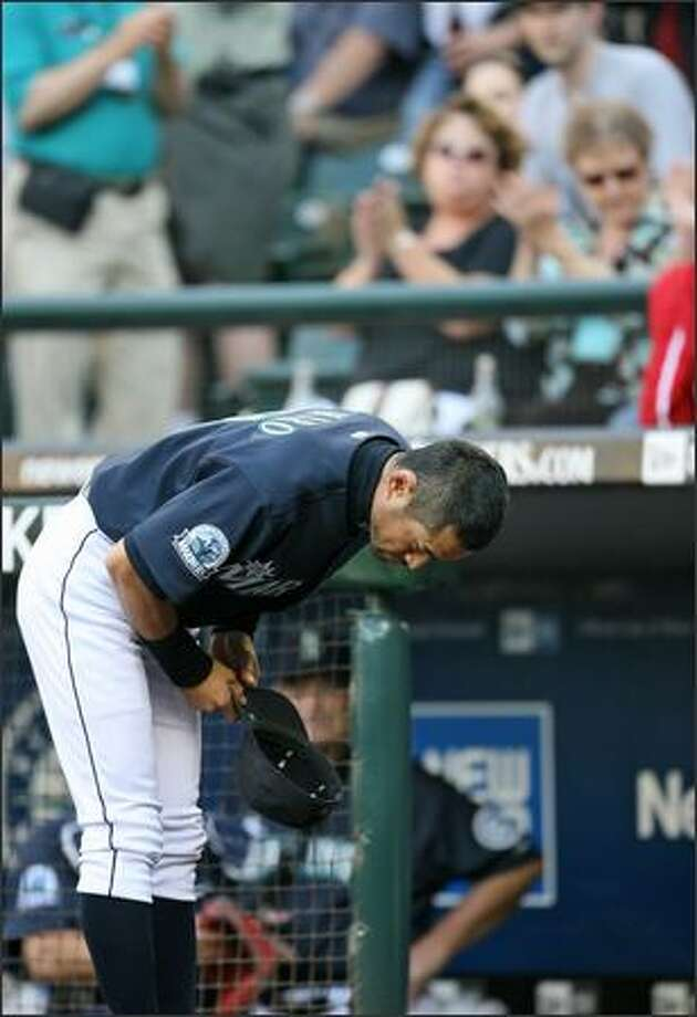 Seattle Mariner Ichiro Suzuki bows to his fans prior to a game against the Detroit Tigers at Safeco Field on Friday. Suzuki signed a five-year contract extension worth an estimated $100 million. Photo: Mike Urban, Seattle Post-Intelligencer / Seattle Post-Intelligencer