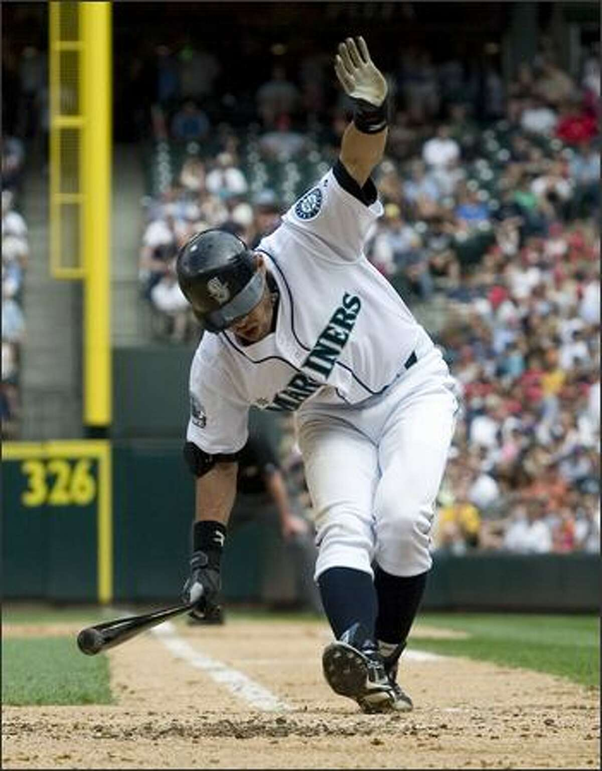 Mariners center fielder Ichiro Suzuki reacts after being hit on his right knee by a pitch by Tigers starter Justin Verlander.