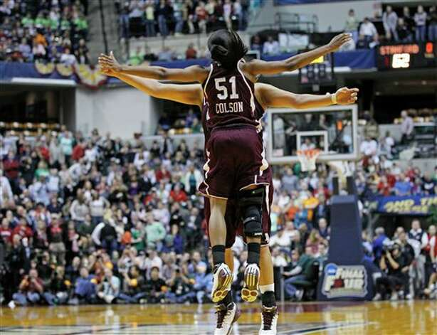 Texas A&M's Sydney Colson (51) celebrates with teammates after their 63-62 win over Stanford in a women's NCAA Final Four semifinal college basketball game in Indianapolis, Sunday, April 3, 2011. Photo: Michael Conroy, AP / AP