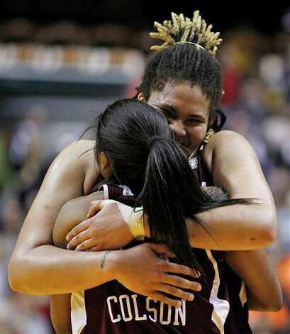 Texas A&M's Danielle Adams embraces Sydney Colson after their 63-62 win over Stanford in a women's NCAA Final Four semifinal college basketball game in Indianapolis, Sunday, April 3, 2011. Photo: Michael Conroy, AP / AP