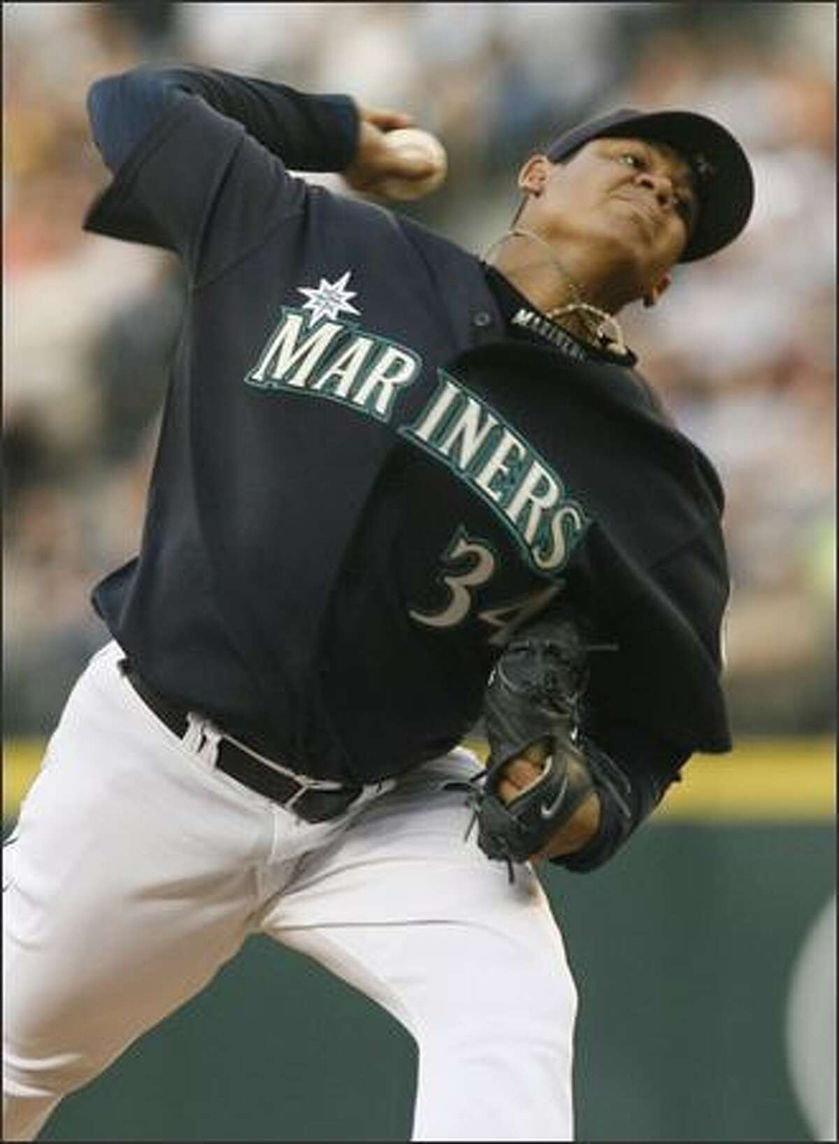 Starting pitcher Felix Herandez works against the Athletics in the third innning of the game between the Mariners and the Athletics in Seattle on Friday.