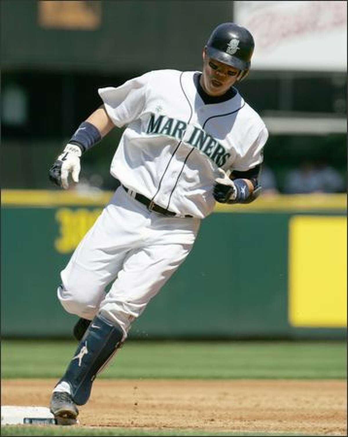 Mariners catcher Kenji Johjima touches third base after hitting a two-run home run in the second inning. Seattle defeated Oakland 4-3. (AP Photo/Kevin P. Casey)