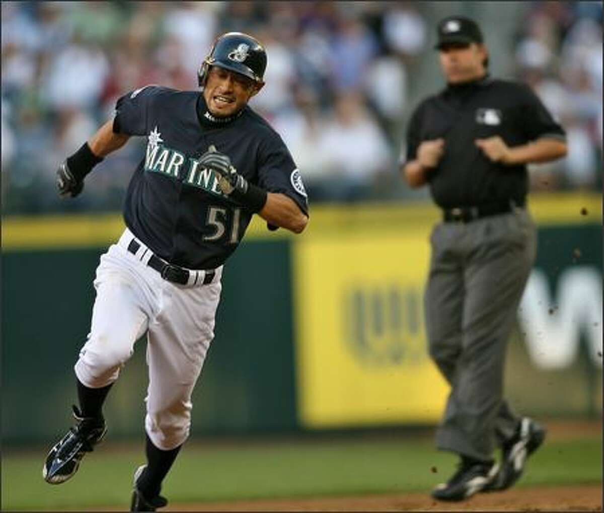 Seattle Mariners Ichiro Suzuki kicks up some dirt as he rounds second heads for third on a fly ball to right field against the Los Angeles Angels during third inning action at Safeco Field in Seattle, Wash., Monday July 30, 2007.