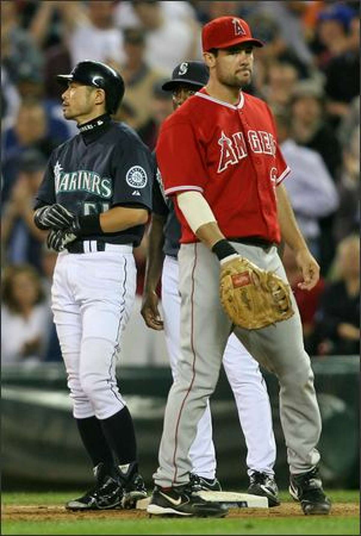 Los Angeles Angels Casey Kotchman digs in at first after missing a ground ball off of Seattle Mariners Ichiro Suzuki during seventh inning action at Safeco Field in Seattle, Wash., Monday July 30, 2007.