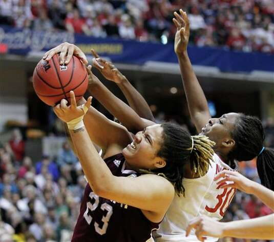Texas A&M's Danielle Adams (23) and Stanford's Nnemkadi Ogwumike (30) fight for the ball in the second half of a women's NCAA Final Four semifinal college basketball game in Indianapolis, Sunday, April 3, 2011. Photo: Michael Conroy, AP / AP