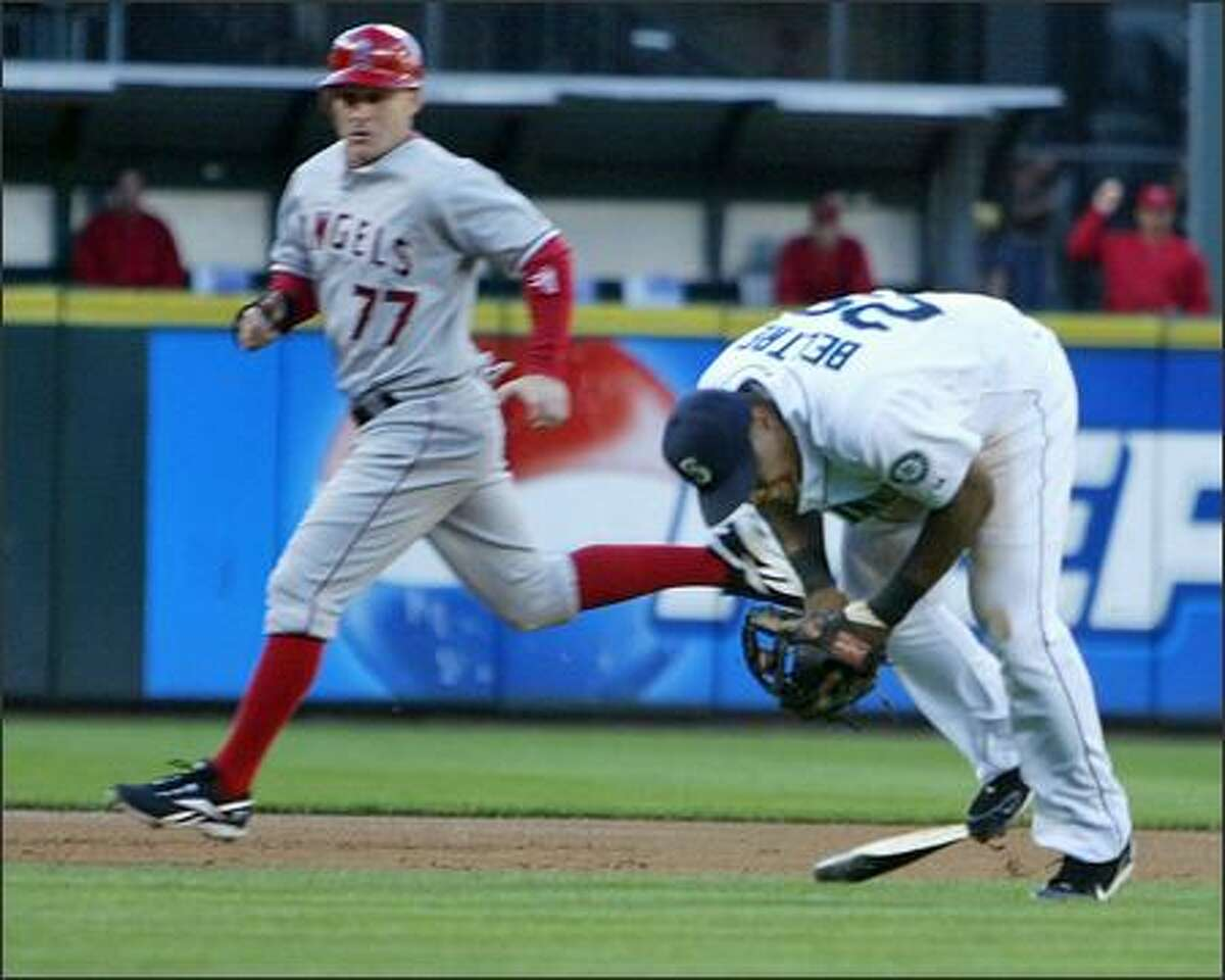 Seattle Mariners' Adrian Beltre (29) trips on Los Angeles Angels' Orlando Cabrera's (18) broken bat as he fields the ball for the out during second inning action at Safeco Field in Seattle, Wash., Tuesday July 31, 2007.