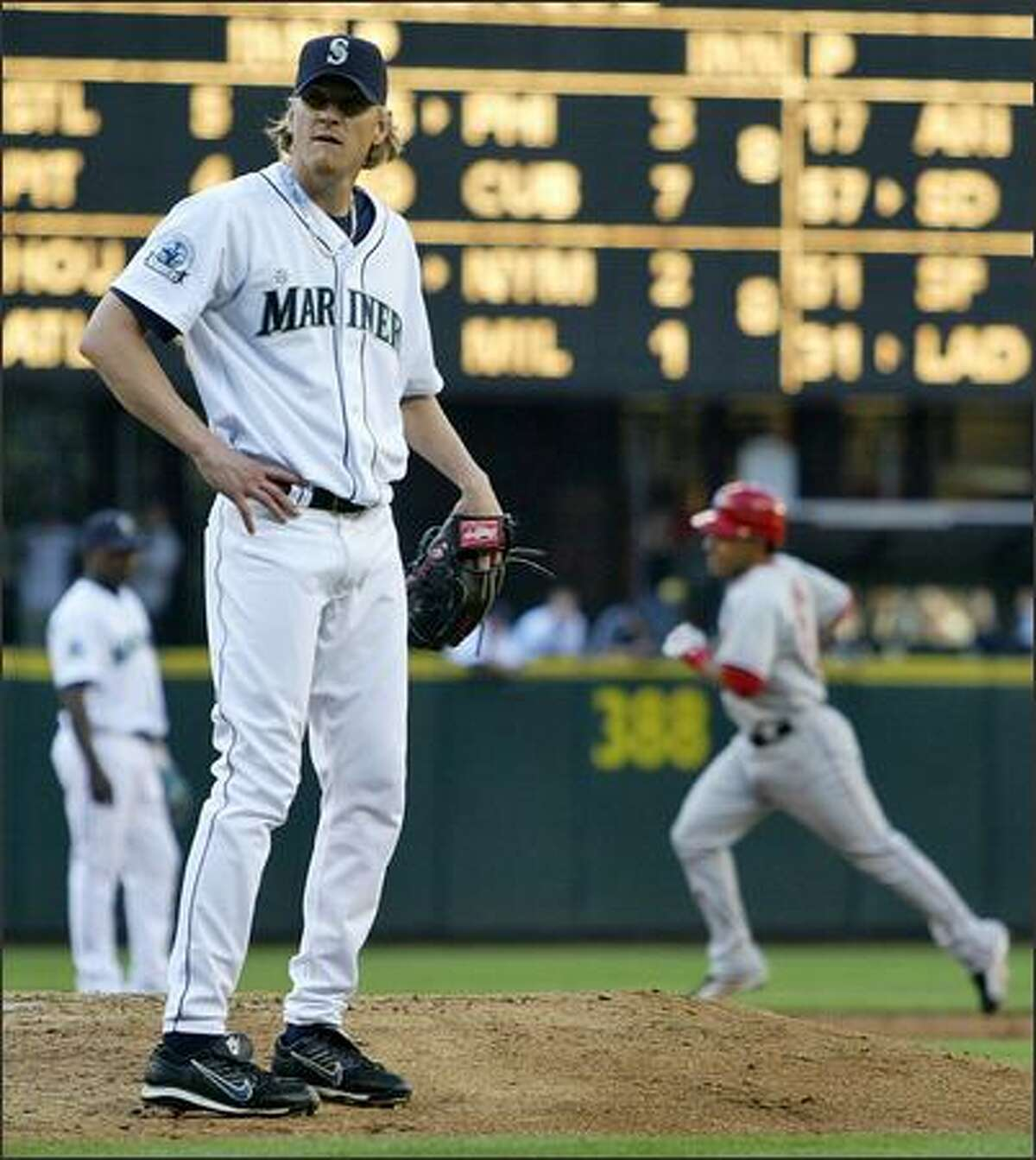 Los Angeles Angels' Maicer Izturis (6) rounds second after hitting a home run off of Seattle Mariners' Jeff Weaver (36) during second inning action at Safeco Field in Seattle, Wash., Tuesday July 31, 2007.