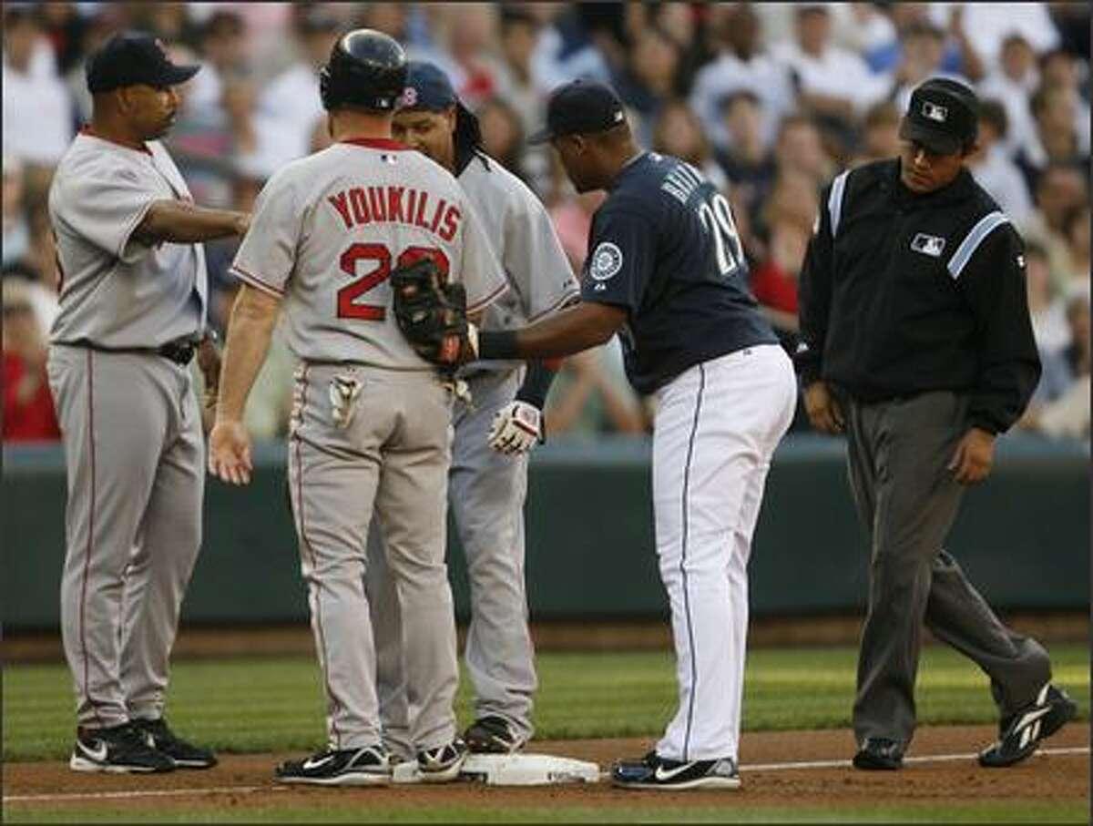 Too many redsox on third. Third base umpire finds both Kevin Youkilis and Manny Ramirez on base.
