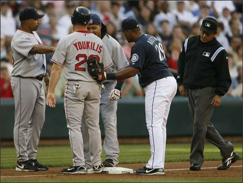 Too many redsox on third. Third base umpire finds both Kevin Youkilis and Manny Ramirez on base. Photo: Grant M. Haller, Seattle Post-Intelligencer / Seattle Post-Intelligencer