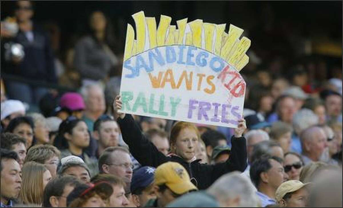 A young fan holds a sign in hopes of getting some free fan fries at Safeco Field, on Monday August 13, 2007.
