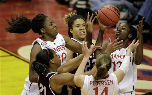 Stanford players Nnemkadi Ogwumike (30), Chiney Ogwumike (13) and Kayla Pedersen (14) go for a rebound against Texas A&M players Danielle Adams (23) and Adaora Elonu (21) in the first half of a women's NCAA Final Four semifinal college basketball game in Indianapolis, Sunday, April 3, 2011. Photo: Amy Sancetta, AP / AP