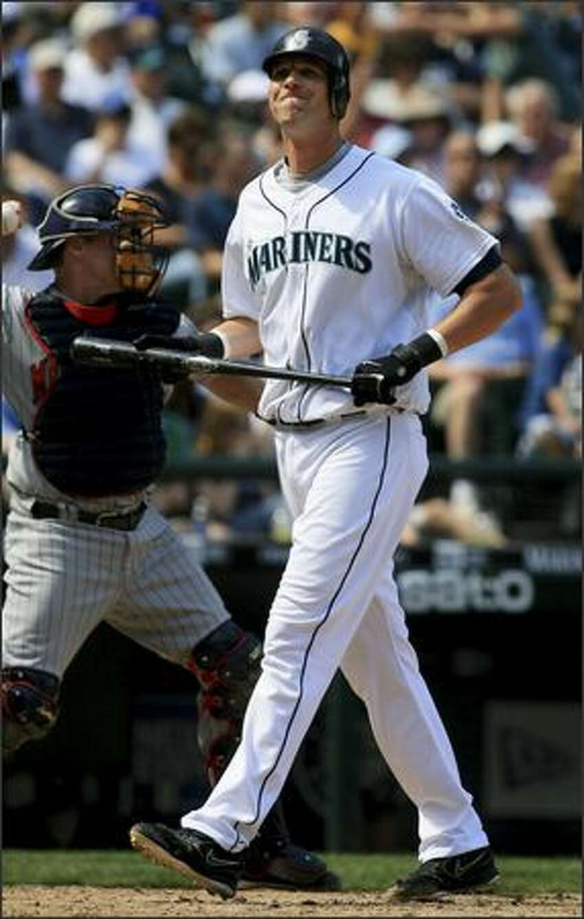 Mariners first baseman Richie Sexson walks toward the dugout after being struck out by Minnesota starter Scott Baker in the fourth inning.