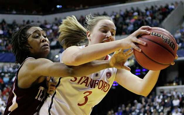 Texas A&M's Tyra White reaches in from behind on Stanford's Mikaela Ruef (3) in the first half of a women's NCAA Final Four semifinal college basketball game in Indianapolis, Sunday, April 3, 2011. Photo: Mark Duncan, AP / AP