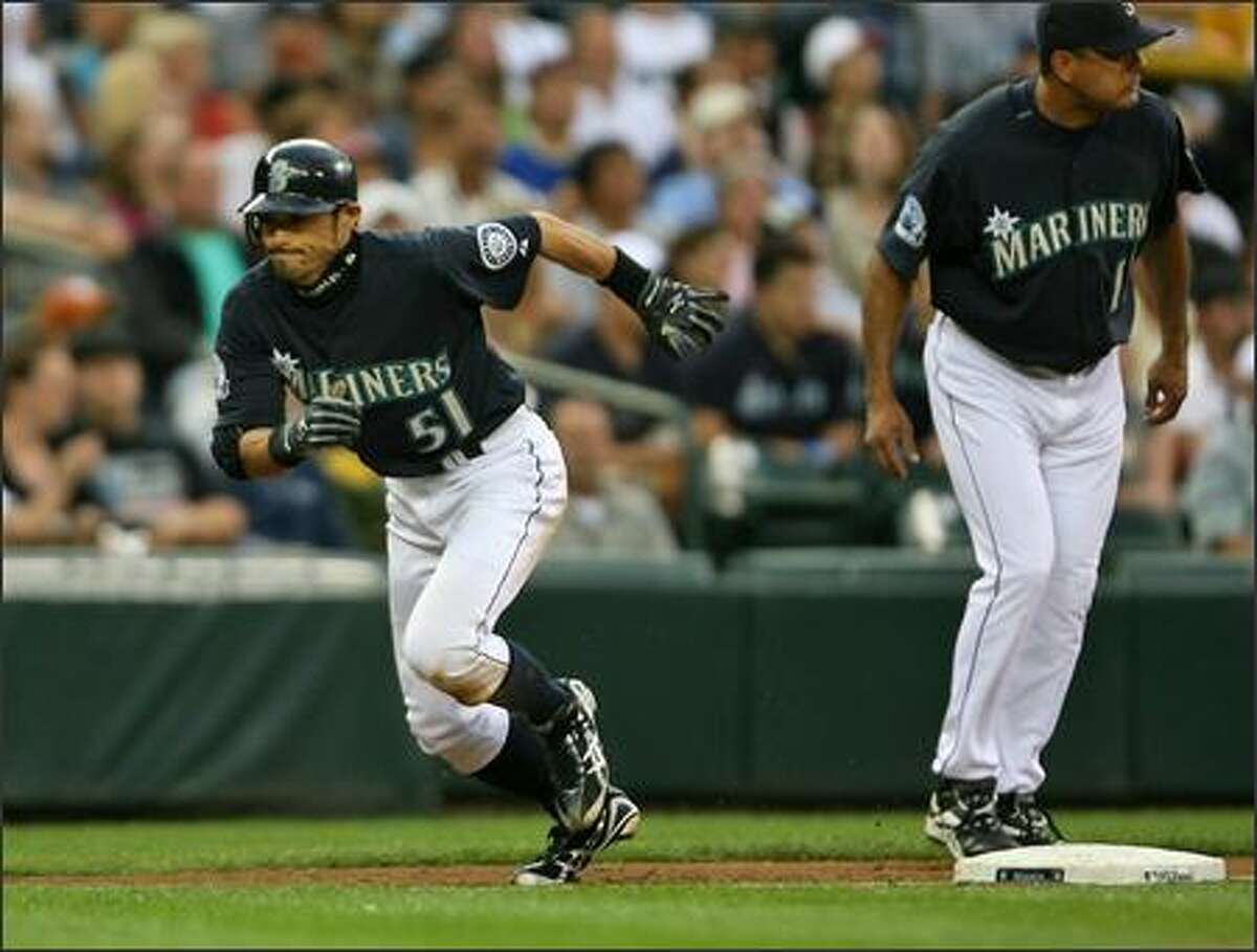 After tagging up Seattle Mariners Ichiro Suzuki sprints home on a sacrifice fly by Jose Vidro as the Mariners play the Chicago White Sox during third inning action at Safeco Field in Seattle, Wash., Friday August 17, 2007.