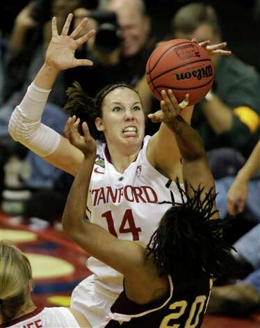 Stanford's Kayla Pedersen (14) blocks a shot by Texas A&M's Tyra White (20)  in the first half of a women's NCAA Final Four semifinal college basketball game in Indianapolis, Sunday, April 3, 2011. Photo: Amy Sancetta, AP / AP