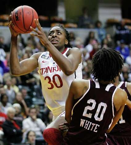 Stanford's Nnemkadi Ogwumike (30) goes to the basket against Texas A&M's Tyra White (20) in the first half of a women's NCAA Final Four semifinal college basketball game in Indianapolis, Sunday, April 3, 2011. Photo: Michael Conroy, AP / AP