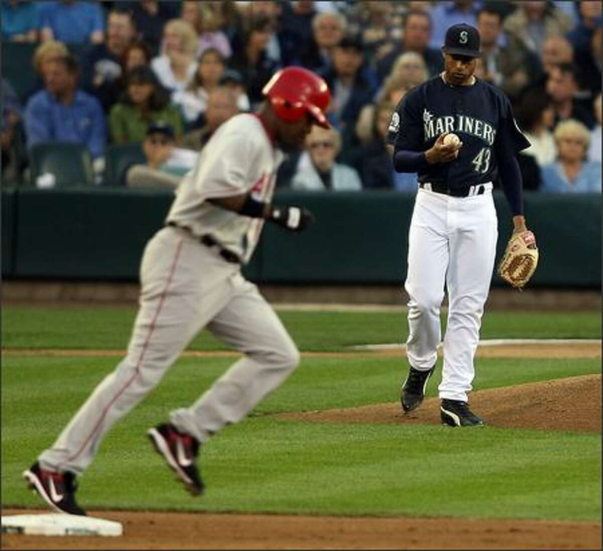Seattle Mariners Miguel Batista examines the ball after giving up a solo home run to Los Angeles Angels Garret Anderson during second inning action at Safeco Field in Seattle, Wash., Monday August 27, 2007.