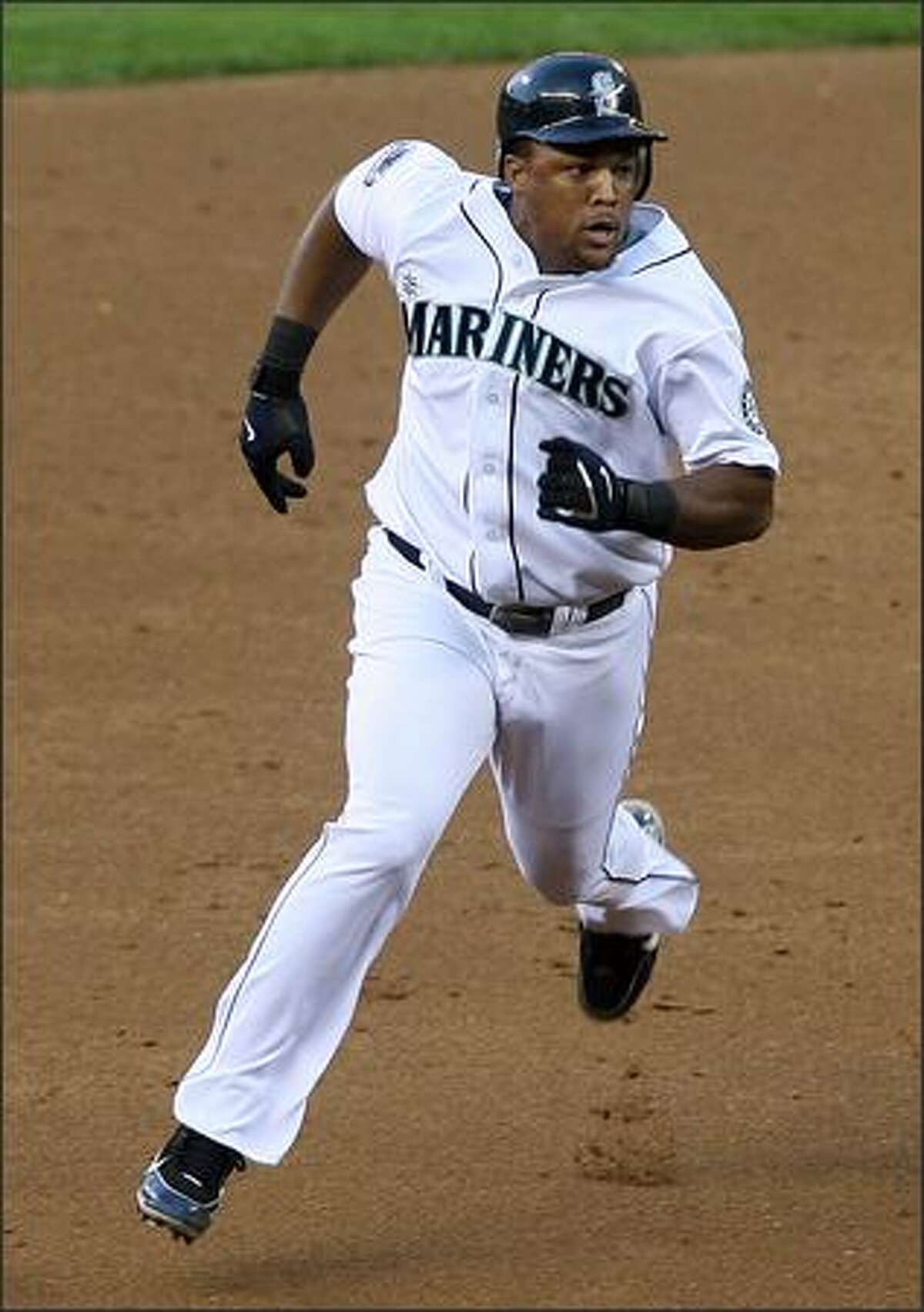 Seattle Mariners Adrian Beltre hustles to third after tripling off of Los Angeles Angels Ervin Santana during first inning action at Safeco Field in Seattle, Wash., Tuesday August 28, 2007. Jose Guillen and Raul Ibanez score.