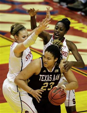Texas A&M's Danielle Adams (23) is double teamed by Stanford's Kayla Pedersen, left, and Chiney Ogwumike in the first half of a women's NCAA Final Four semifinal college basketball game in Indianapolis, Sunday, April 3, 2011. Photo: Amy Sancetta, AP / AP
