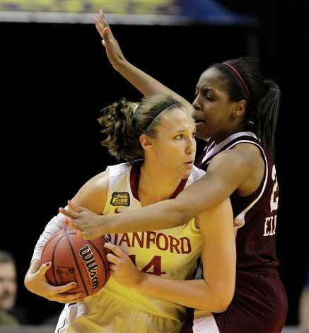 Texas A&M's Adaora Elonu reaches in for the ball against Stanford's Kayla Pedersen (14) in the first half of a women's NCAA Final Four semifinal college basketball game in Indianapolis, Sunday, April 3, 2011. Photo: Mark Duncan, AP / AP